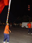 Photo of a flag bearer balancing flag on his forehead