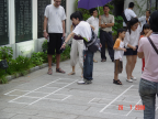 Photo of parents teaching the children to play 'cit-cit chom'