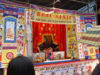 Photo of puppet show on stage opposite the temple